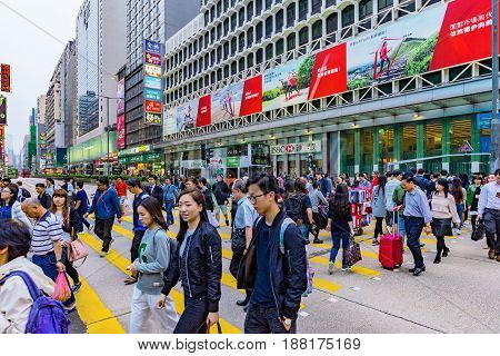 HONG KONG CHINA - APRIL 24: This is a crowded street crossing in the busy Mong Kok area of Kowloon where you can see many tourists and local people on April 24 2017 in Hong Kong