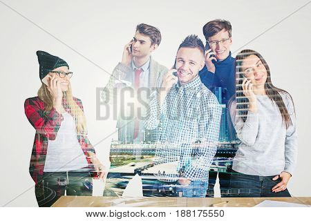 Attractive cheerful caucasian team members talking on the phone in office. Double exposure. Communiction concept