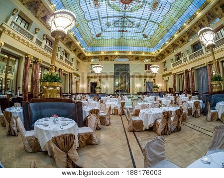 MOSCOW RUSSIA - APRIL 27 2017: Main restaurant in Metropol hotel with beautiful stained-glass ceiling roof in Moscow Russia on April 27 2017. Hotel was built in 1899-1907 in Art Nouveau style.