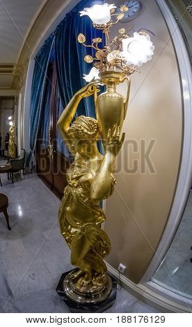 MOSCOW RUSSIA - APRIL 27 2017: Statue floor lamp and decorative door in Metropol hotel in Moscow Russia on April 27 2017. Hotel was built in 1899-1907 in Art Nouveau style.