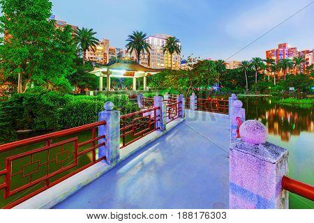 Traditional bridge and lake in Zhongshan park at night