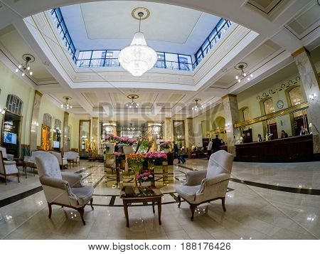 MOSCOW RUSSIA - APRIL 27 2017: Metropol hotel lobby and reception desk in Moscow Russia on April 27 2017. Hotel was built in 1899-1907 in Art Nouveau style.