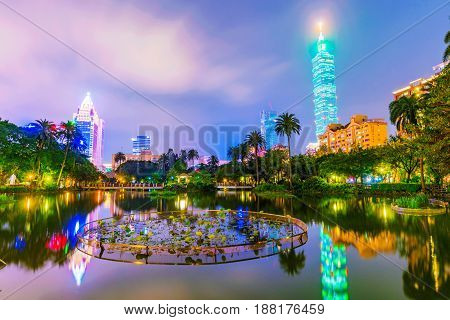 TAIPEI TAIWAN - APRIL 20: This is a night view of Zhonghsan park and Taipei 101 building in donwtown Taipei on April 20 2017 in Taipei