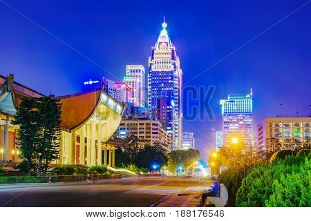 TAIPEI TAIWAN - APRIL 20: This is a view of Sun Yat-Sen memorial hall a famous historic landmark with Xinyi financial district in the background at night on April 20 2017 in Taipei