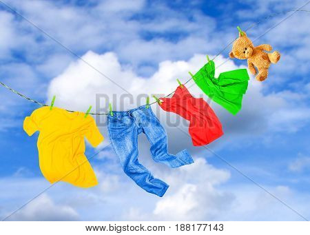 Laundry line with colored clothes against the sky