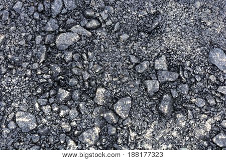 The texture of asphalt with large stones