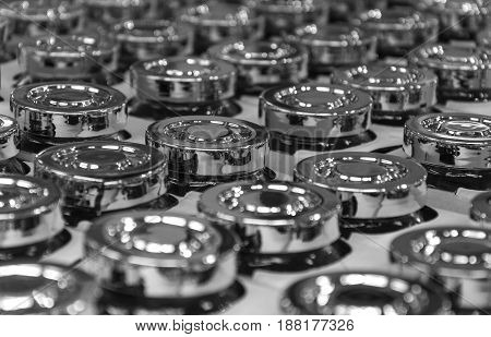Metal lids from cans in the black-and-white photo