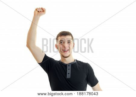 handsome gay guy raises his hand up and yells open-mouthed isolated on white background