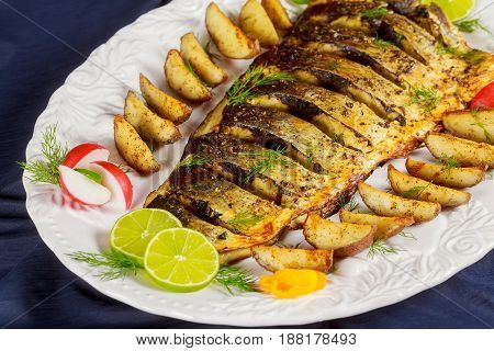 Oven Baked Grilled Fish With Roasted Potatoes And Vegetables