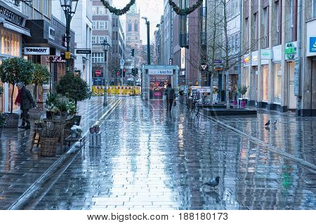 DUESSELDORF, GERMANY - JANUARY 05, 2017: View into a street near the Altstadt after rain started - high resolution - hyperrealistic.
