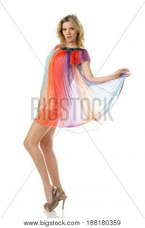 young beautiful sexy woman dancing in colourful dress