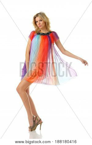 sexy girl dancing in colourful mini dress and looking at you. studio isolated image