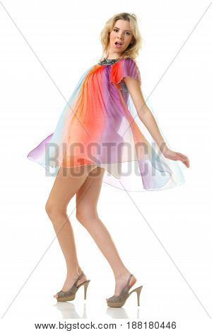 young beautiful woman with long legs dancing