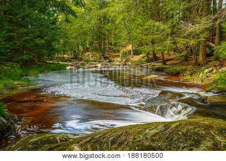 Small pond at the base of Potts Falls near Bracebridge Ontario Canada.