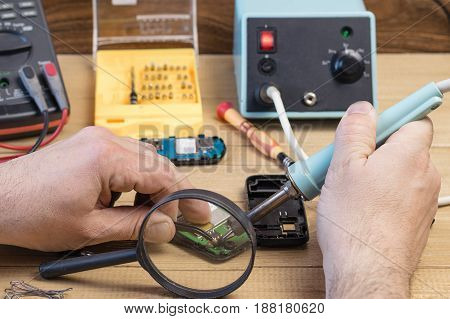 Spare parts and tools for repair of your mobile phone. The concept of mobile phone repair.