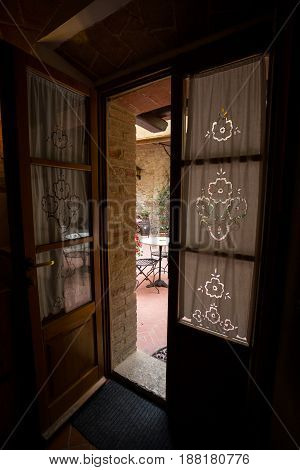 View of the Italian courtyard through the doorway italy
