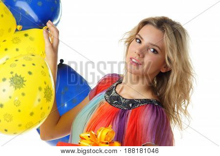 portrait of young pretty woman with colourful balloons looking in camera