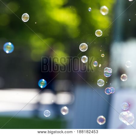 Beautiful soap bubbles fly in the nature .