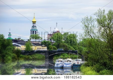 River with boats and bell tower with St. Sophia Cathedral in the distance