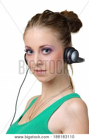 young woman or female listening music and looking at you or in camera