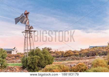 Dusk farm scene with a broken windmill on a farm near Montagu in the Western Cape Province