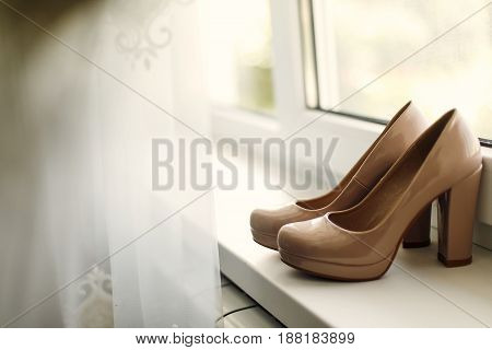 Beautiful Beige Shoes On The Window In The Morning, Bridal Morning, Wedding Preparation.