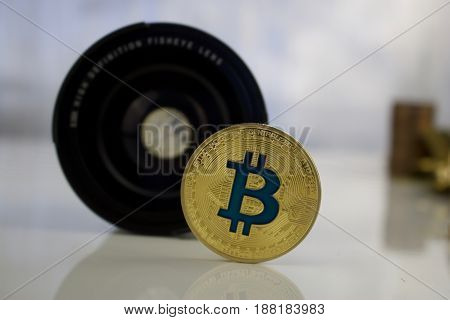 Gold Bitcoin Coin Near Lenses