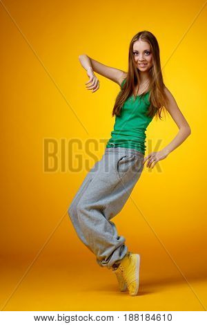 young woman - rnb dancer on yellow background
