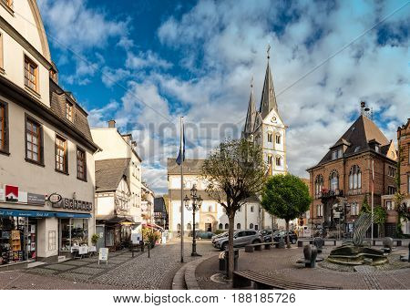 BOPPARD, GERMANY - NOVEMBER 06, 2016: Historic buildings from different epochs frame the historic market and the central church