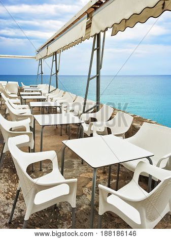 White tables in a cafe by the seaside. Peniscola resort in the province of Castellon Valencian Community Spain.