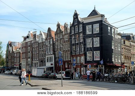AMSTERDAM NETHERLANDS - MAY 14 2017: Historical houses with sloping facades