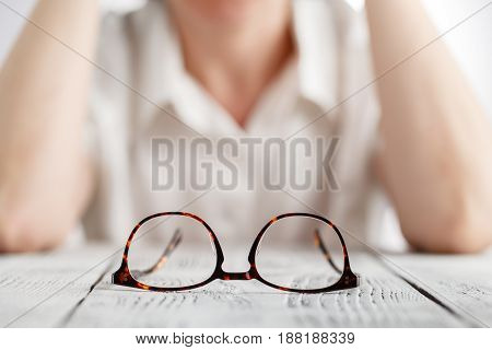 Sensual business woman with spectacles on table