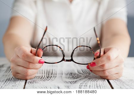 Woman Holding Glasses On A White Background