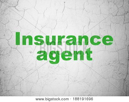 Insurance concept: Green Insurance Agent on textured concrete wall background