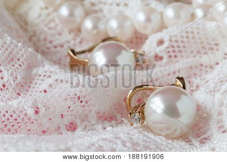 Background Of White Delicate Lace Fabric And Pearls