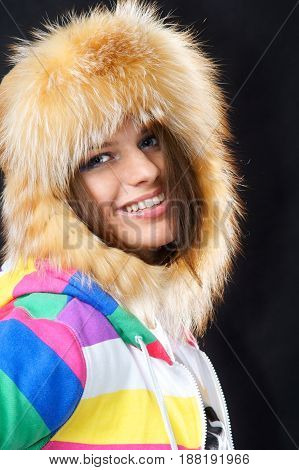 emotional studio portrait of young attractive woman smiling