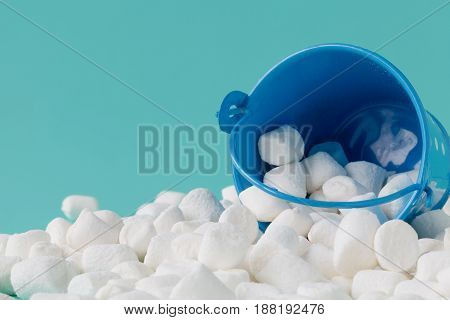 Marshmallow In Basket On Blue Background. Close Up