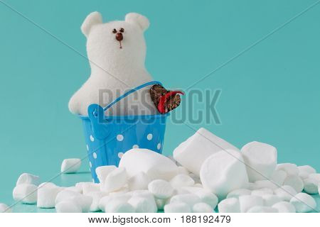 Pile Of Small Puffy Marshmallows On Aquamarine Background Close Up