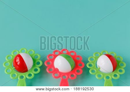 Colorful Rattle Baby Toy Isolated On Blue Background