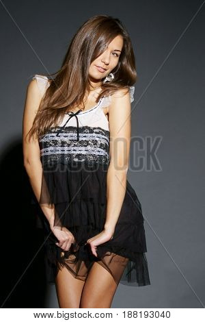 fashion style studio photo of young sensual lady in summer dress