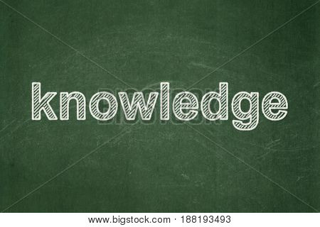 Education concept: text Knowledge on Green chalkboard background