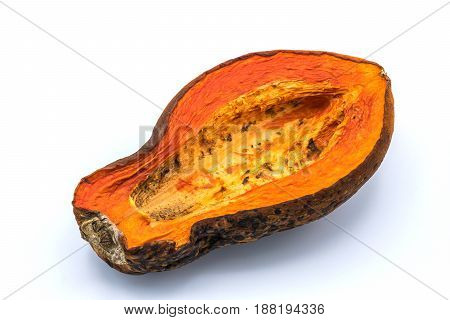 Papaya is ripe yellow-orange. It was kept so rotten and moldy on isolated white background.