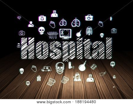 Health concept: Glowing text Hospital,  Hand Drawn Medicine Icons in grunge dark room with Wooden Floor, black background