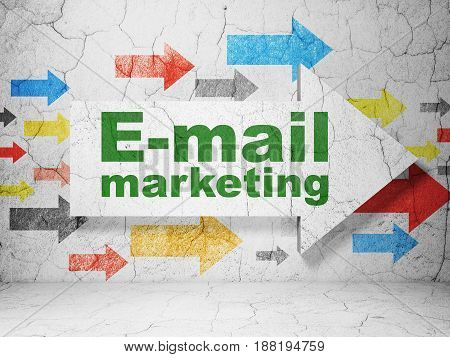 Marketing concept:  arrow with E-mail Marketing on grunge textured concrete wall background, 3D rendering