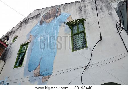 Little Girl In Blue Street Art Mural By Lithuanian Artist