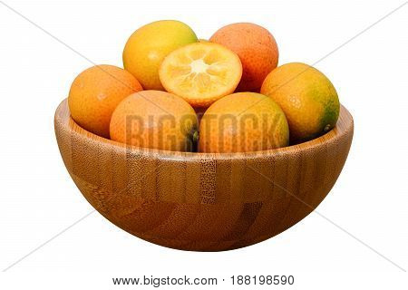 ripe kumquat fruit in wooden bowl isolated on white background with clipping path