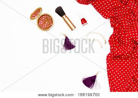 Red Feminine Dress, Makeup Brush, Nail Polish, Pearl Bracelet And Earrings On A White Background. Mi