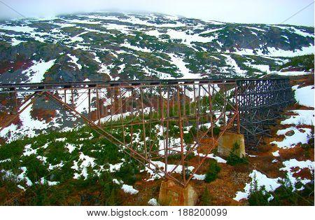 Old unused train bridge in the mountains