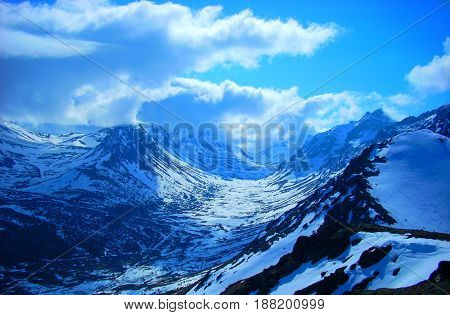 Snowy high mountain pass in Alaska during winter