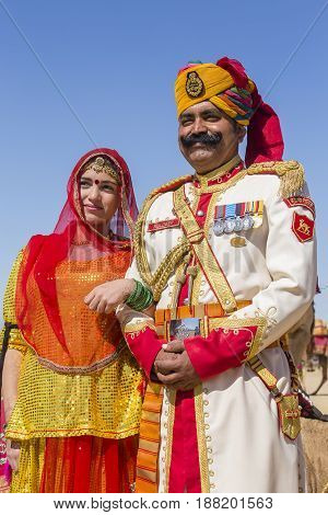 JAISALMER INDIA - FEBRUARY 09 2017 : Unidentified woman and man wearing traditional Rajasthani dress participate in Mr. Desert contest as part of Desert Festival in Jaisalmer Rajasthan India. Close up